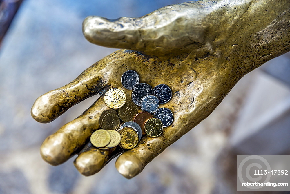 Fisherman sculpture with coins in it's hand in a harbour, Opatija, Primorje-Gorski Kotar County, Croatia