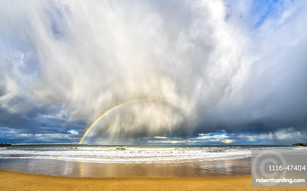 Rainbow through storm clouds viewed from a beach, South Shields, Tyne and Wear, England