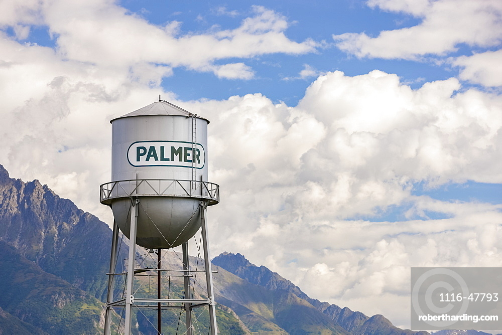 Downtown Palmer water tower, cloudy skies and the Chugach Mountains in the background, South-central Alaska,, Palmer, Alaska, United States of America