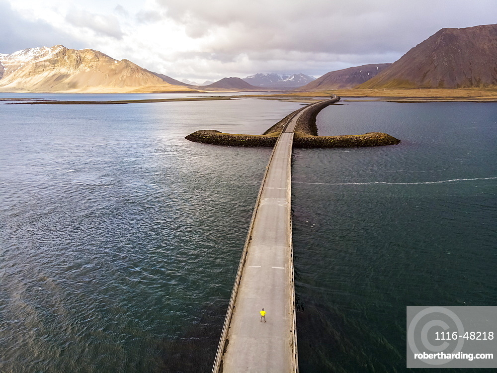 Man standing on bridge in Iceland. Image taken with a drone, Grundarfjorour, Iceland