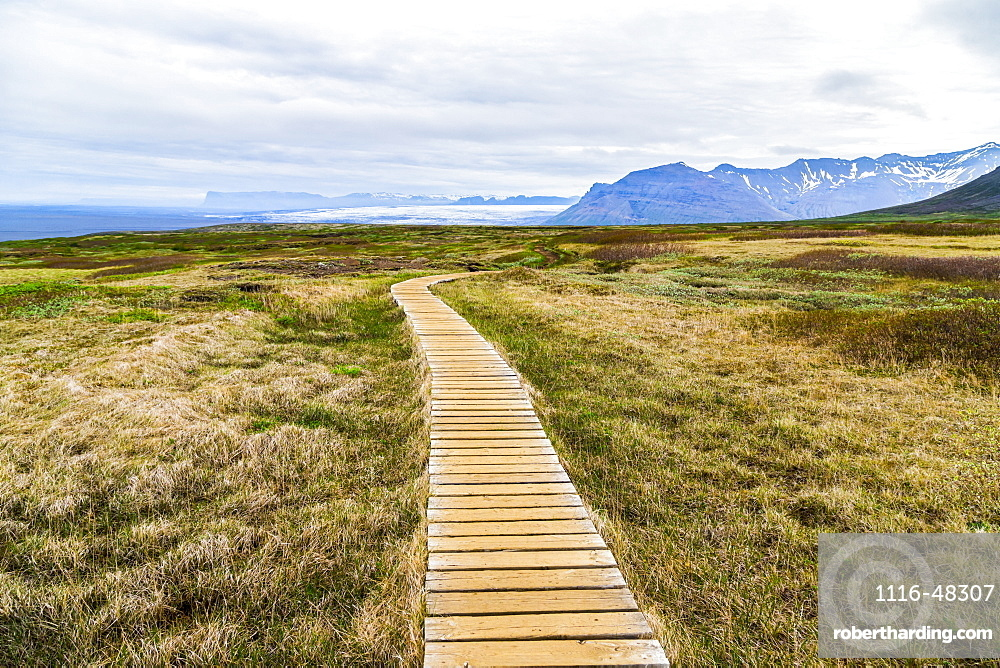 A boardwalk path leads hikers through the hiking route on the Vatnajokull National Park plateau, Iceland