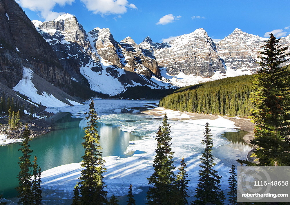 NoneSnow and ice on Moraine Lake with snow on the Rocky Mountains near Lake Louise, Banff National Park, Alberta, Canada