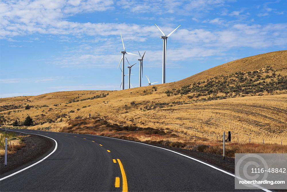 Wind turbines are found along a road in Gilliam County, Arlington, Oregon, United States of America