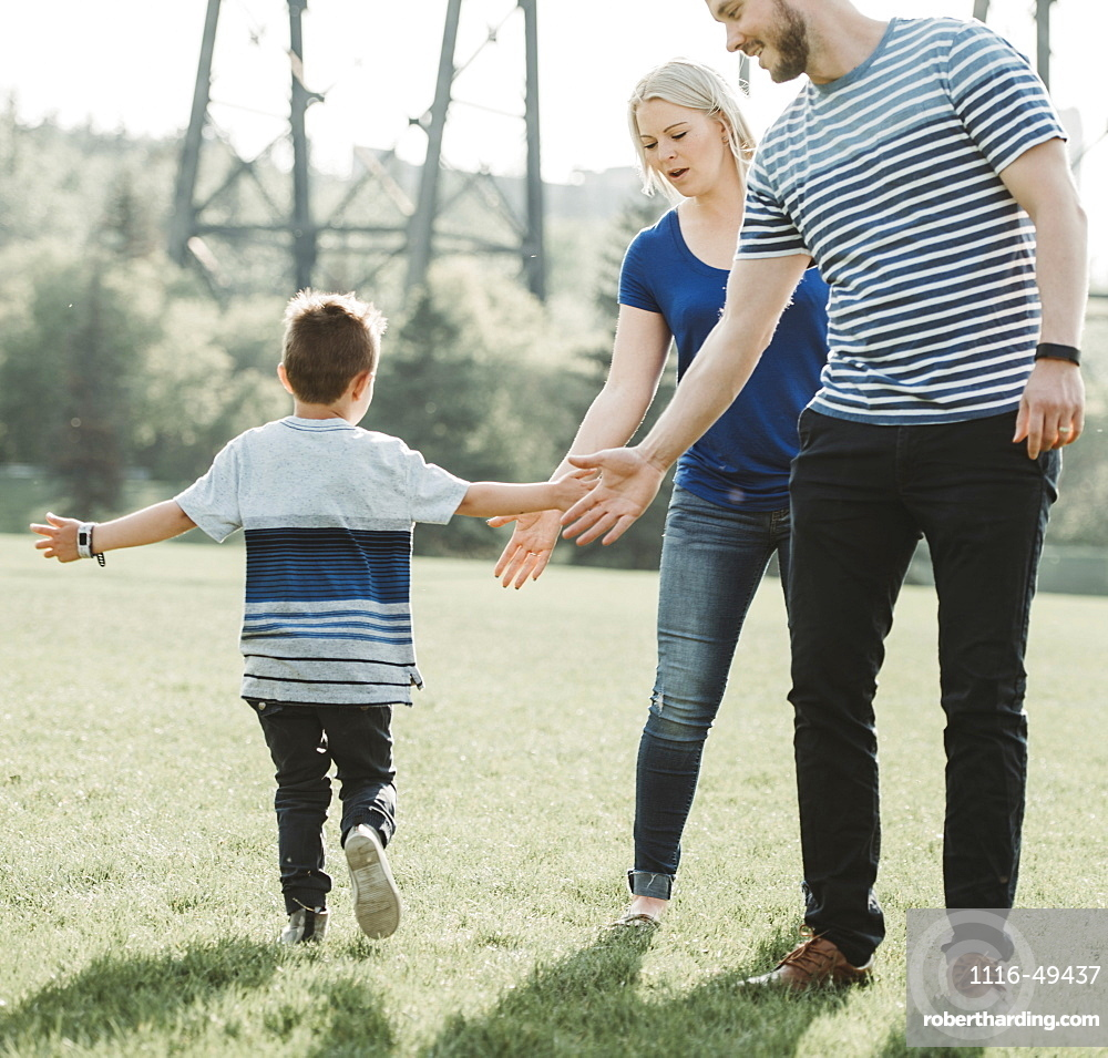 A family with young son playing in a park, Edmonton, Alberta, Canada