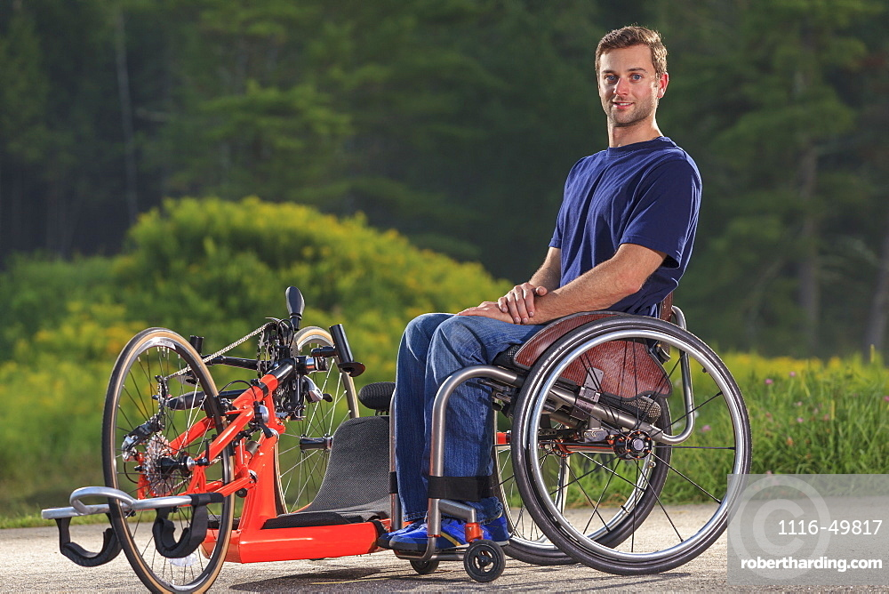 Man with spinal cord injury in his wheelchair with his custom adaptive hand cycle