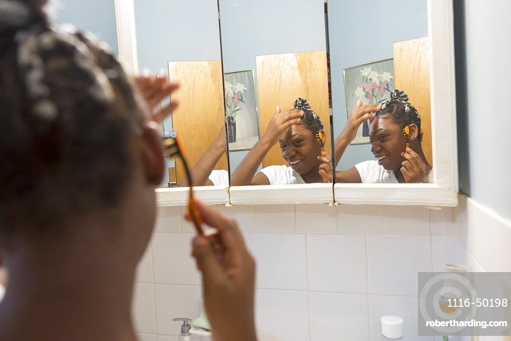Teen suffering from Bipolar Disorder doing her hair