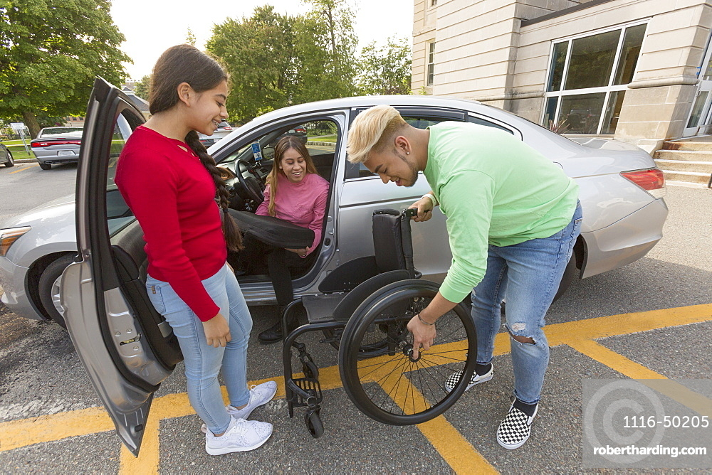 Woman with Spinal Cord Injury getting out of her car