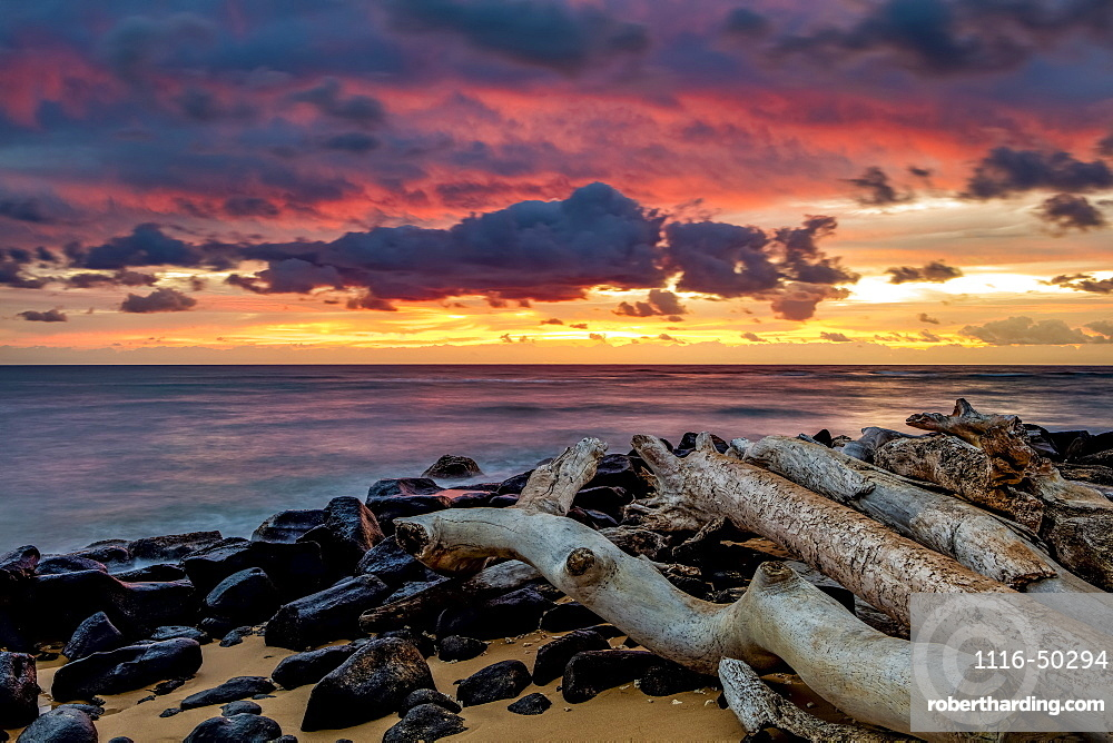 Sunrise over the Pacific Ocean from the shore of Lydgate Beach; Kapaa, Kauai, Hawaii, United States of America