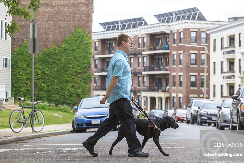 Man with Visual Impairment walking with his service dog