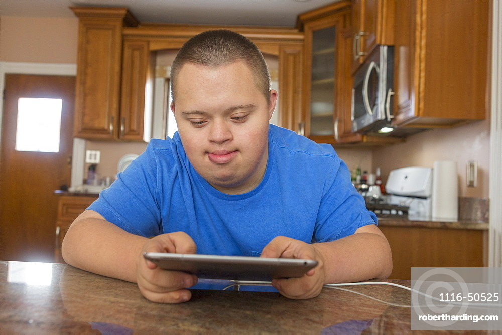 Teen with Down Syndrome using computer