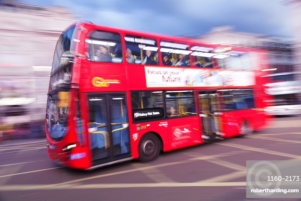 Motion blurred red double decker bus, Piccadilly Circus, London, England, United Kingdom, Europe