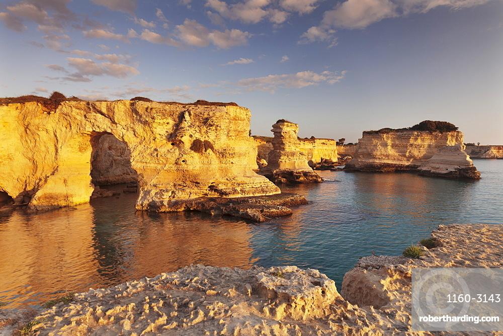 Rocky columns, natural monument, rocky coast at sunrise , Sant'Andrea, Adriatic Sea, Lecce province, Salentine Peninsula, Puglia, Italy, Mediterranean, Europe