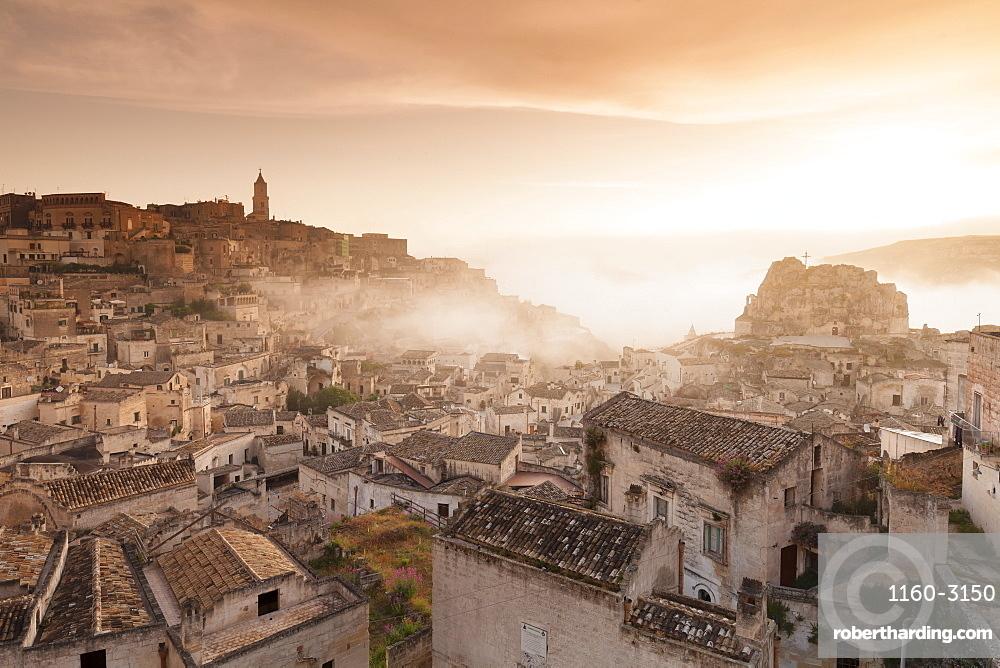 View over Sasso Caveoso to Monte Errone and cathedral at sunrise, UNESCO World Heritage Site, Matera, Basilicata, Puglia, Italy, Europe