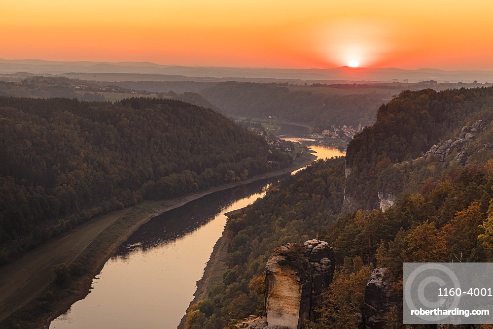 Elbe river at sunset in Elbe Sandstone Mountains, Germany, Europe