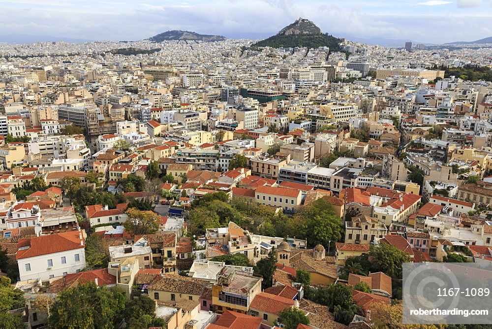 Elevated Athens city view from the Acropolis, towards Lykavittos Hill and Parliament across Plaka and Syntagma, Athens, Greece, Europe