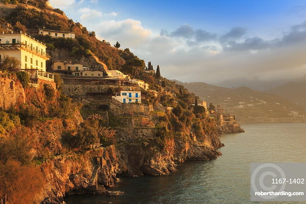 Sunrise lights up villas, misty dawn on the Amalfi Coast, near Atrani in spring, UNESCO World Heritage Site, Campania, Italy, Europe