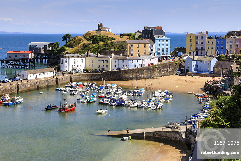Harbour Beach, boats, colourful historic buildings, Castle Hill, lifeboat station on a sunny day, Tenby, Pembrokeshire, Wales, Europe