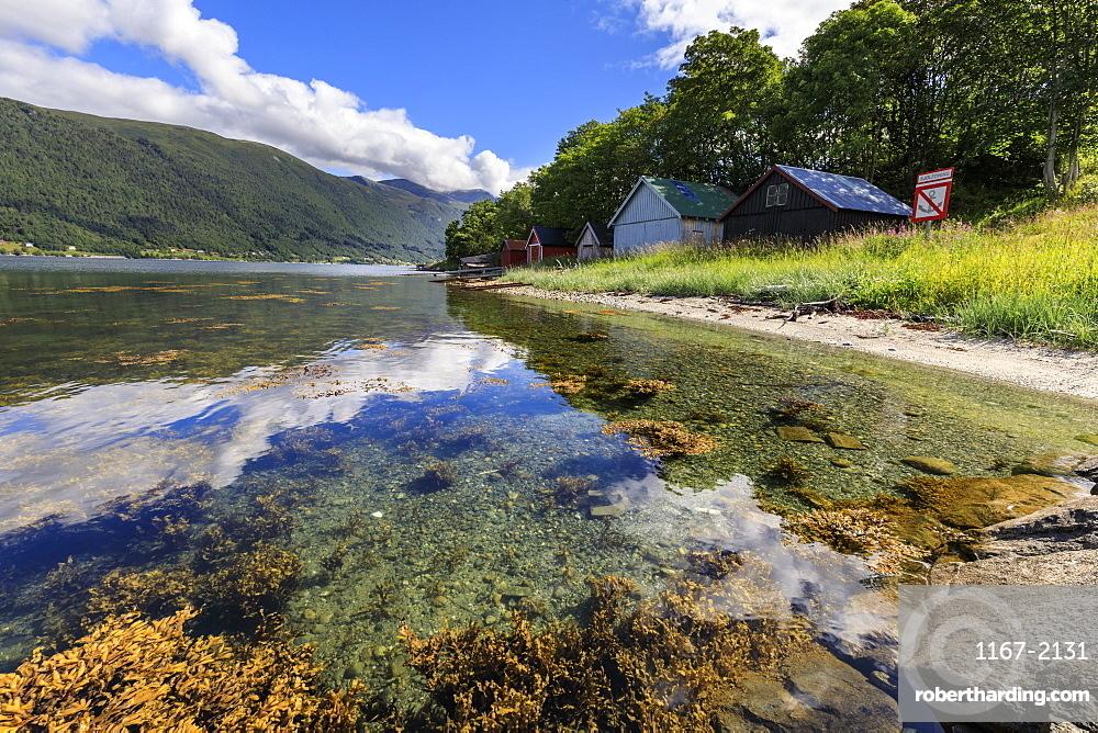 Old wooden boat houses, Romsdalsfjord (Romsdal Fjord), Andalsnes, More og Romsdal, Norway, Scandinavia, Europe
