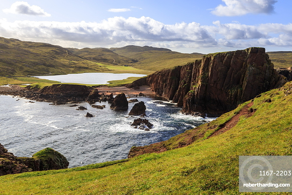 North Ham Bay, deep inlet, elevated view, red granite cliffs, stacks, Town Loch, Muckle Roe Island, Shetland Isles, Scotland