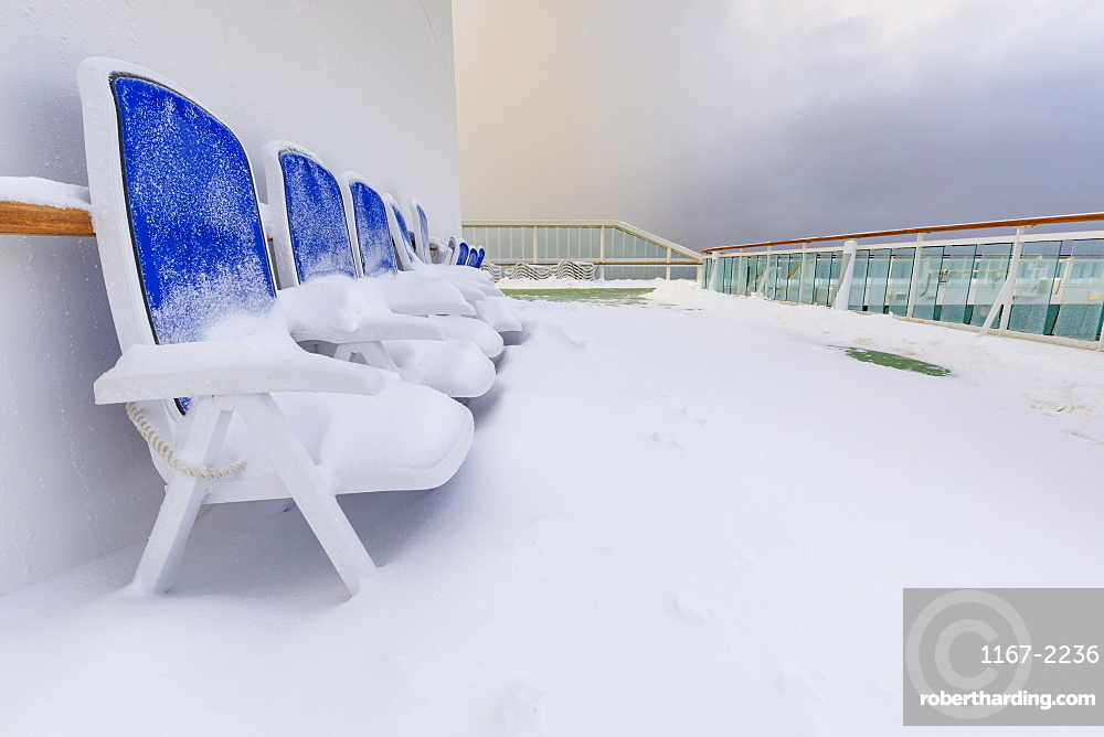 Cruise ship on an Arctic Winter voyage, fresh powder snow on decks, off Troms County, North Norway, Scandinavia, Europe