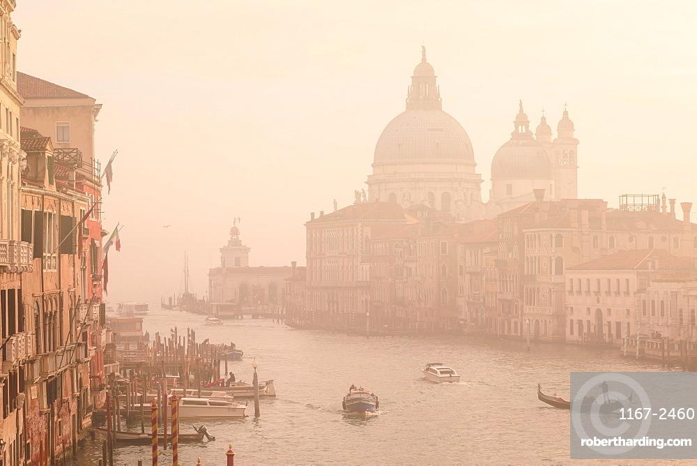 Beautiful Grand Canal, winter fog, morning golden light, Santa Maria della Salute, Venice, UNESCO World Heritage Site, Veneto, Italy, Europe