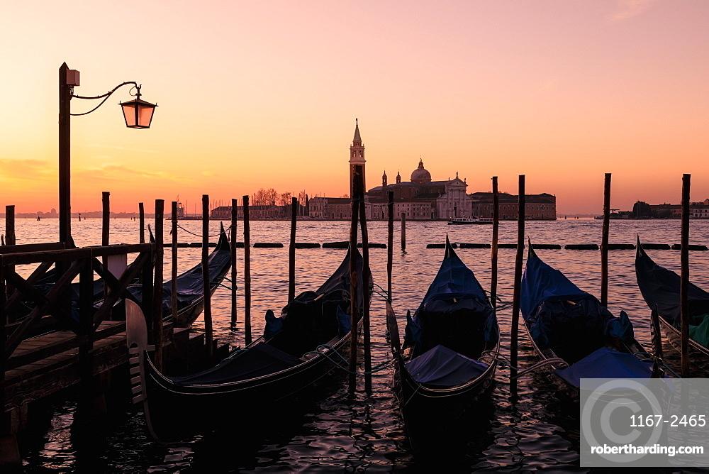 Beautiful Venetian sunrise in winter, gondolas, San Giorgio Maggiore and Lido, Venice, UNESCO World Heritage Site, Veneto, Italy, Europe