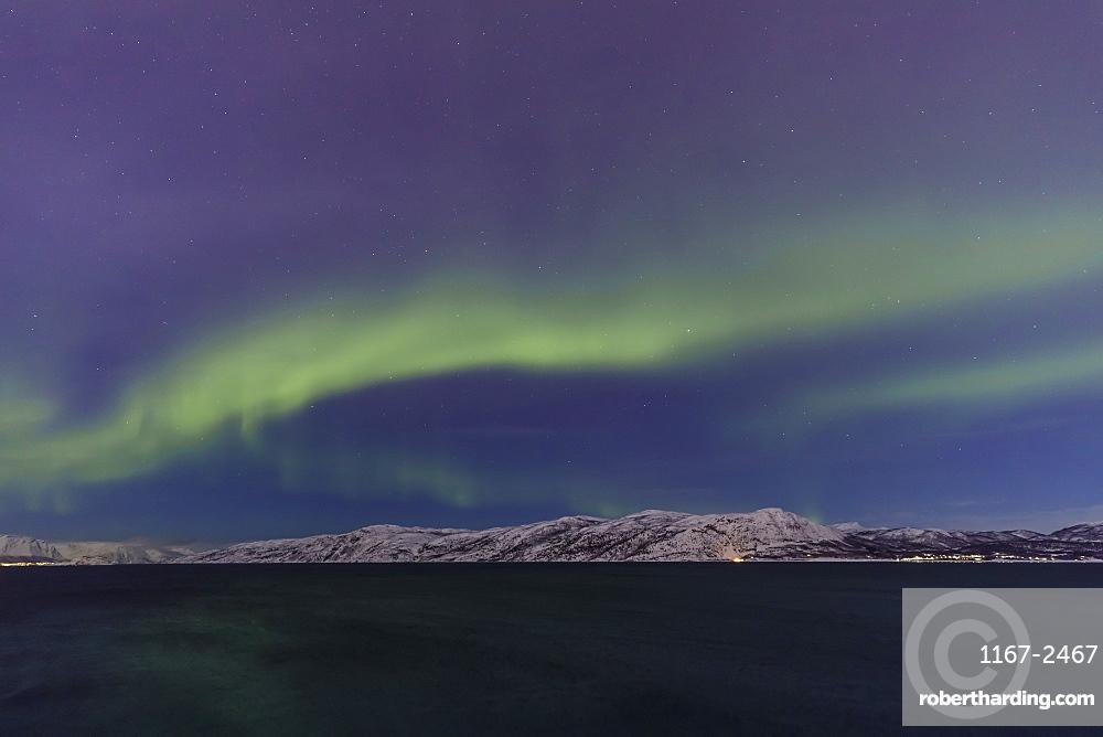 Northern Lights, Aurora Borealis, over mountains of Altafjord, Alta, Troms og Finnmark, Winter, Arctic Circle, North Norway