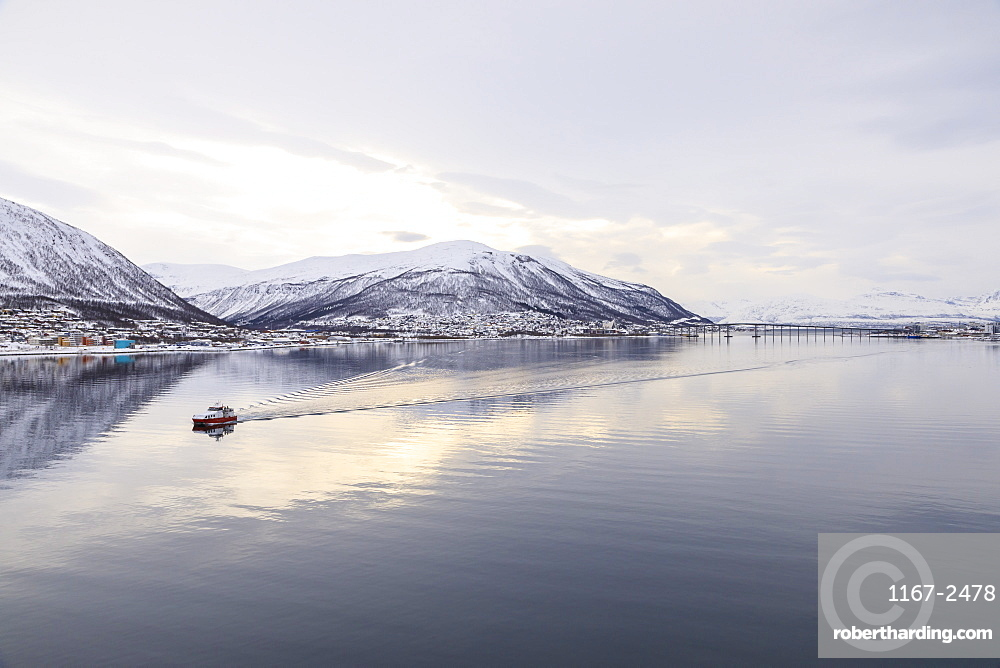 Tromso, from its fjord, city covered in snow, boat, Arctic Cathedral, bridge, mountains, Winter, Troms og Finnmark, North Norway