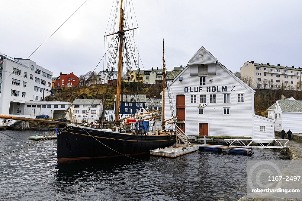 Beautiful Alesund, waterfront, historic boat, wooden warehouse, Winter, More og Romsdal, Norway, Scandinavia