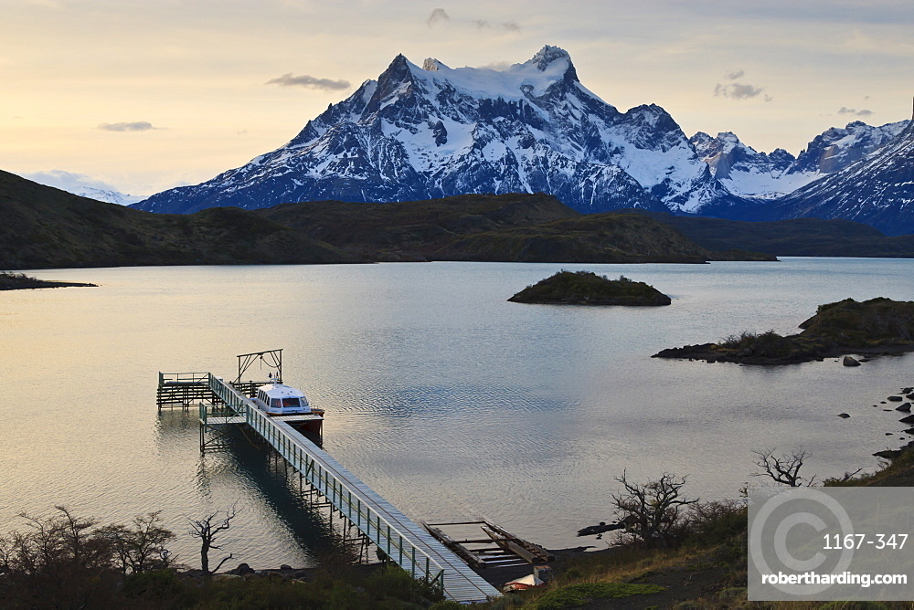 Lago Pehoe boat and dock with the Cordillera del Paine at sunset, Torres del Paine National Park, Patagonia, Chile, South America