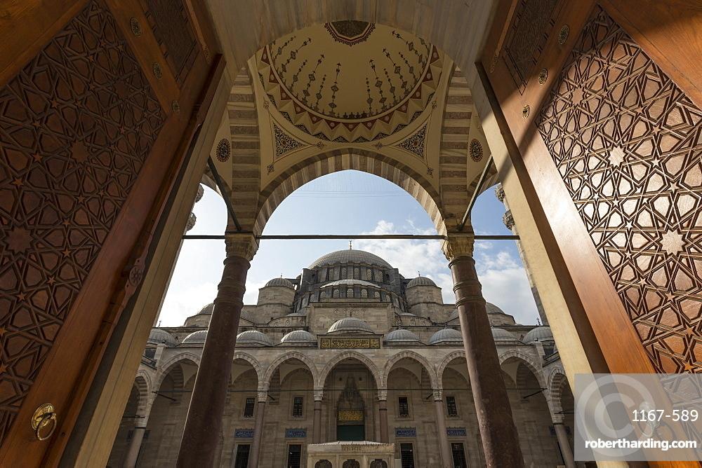 Ornate wooden doors, Courtyard entrance, early morning, Suleymaniye Mosque, Bazaar District, Istanbul, Turkey, Europe