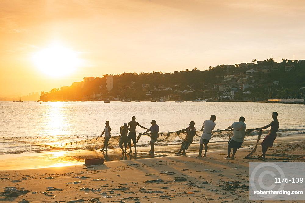 Fishermen on the beach in Niteroi, with the Rio skyline in the background, Rio de Janeiro, Brazil, South America