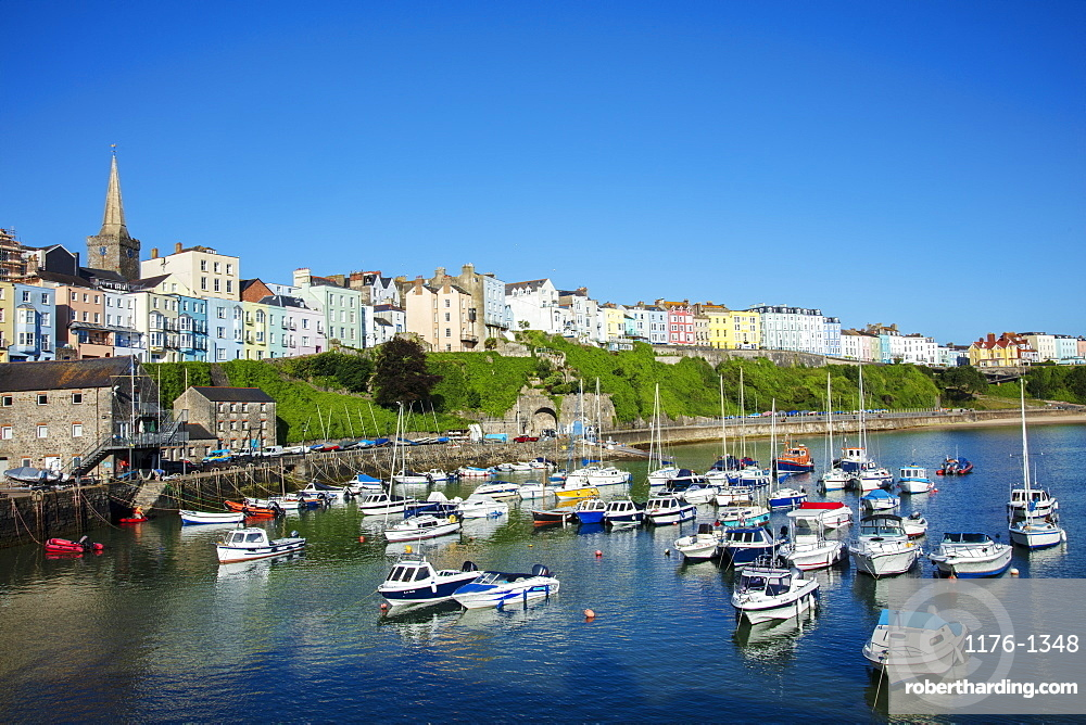 View of the town centre and fishing boats in the harbour, Tenby, Pembrokeshire, Wales, United Kingdom, Europe