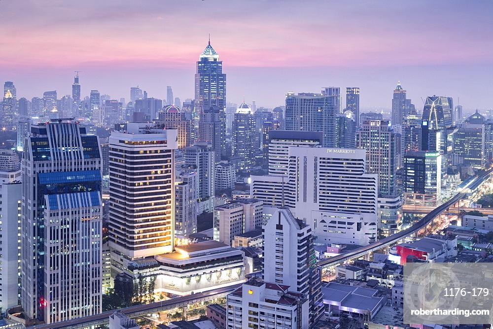 City skyline looking along the BTS Skytrain, Sukhumvit Road and Phloen Chit to Phloen Chit station, Bangkok, Thailand, Southeast Asia, Asia