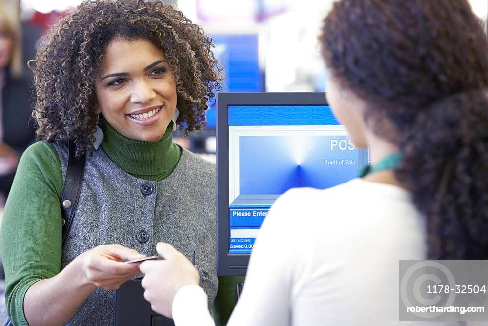 African woman paying with credit card