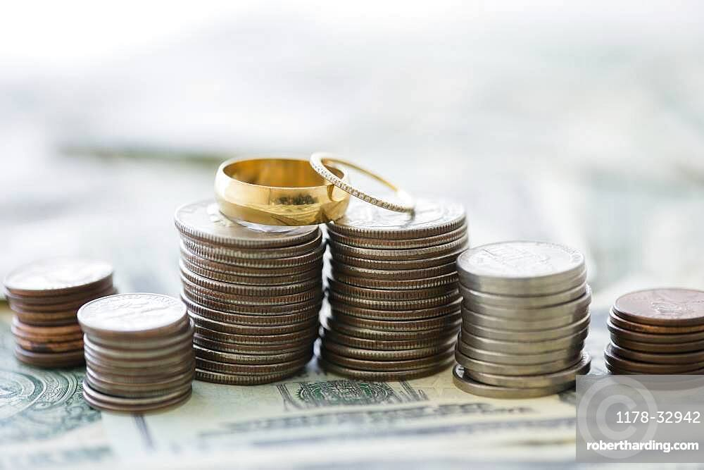 Close up of stacks of coins and wedding rings