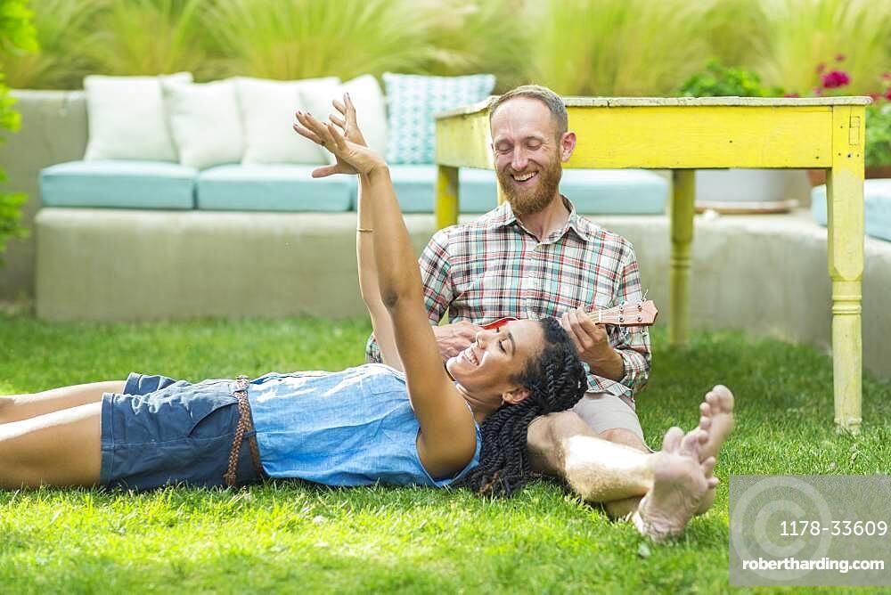 Couple relaxing in backyard