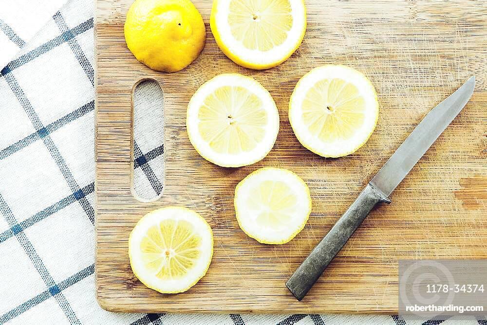 Sliced lemon on wooden cutting board