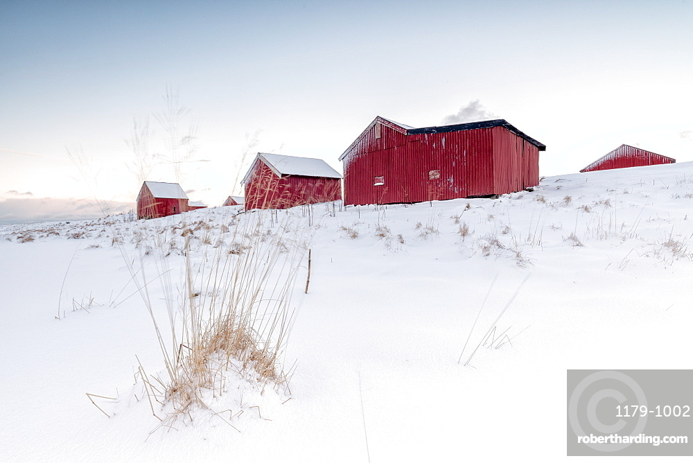 Fresh snow surrounds the typical fishermen houses called Rorbu in winter, Eggum, Vestvagoy (Vest-Vagoy) Island, Lofoten Islands, Arctic, Norway, Scandinavia, Europe