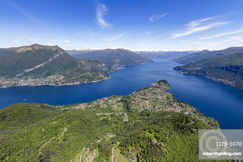 Aerial view of the village of Bellagio frames by the blue water of Lake Como on a sunny spring day, Italian Lakes, Lombardy, Italy, Europe