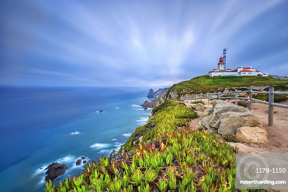 Sunrise on the cape and lighthouse of Cabo da Roca overlooking the Atlantic Ocean, Sintra, Portugal, Europe