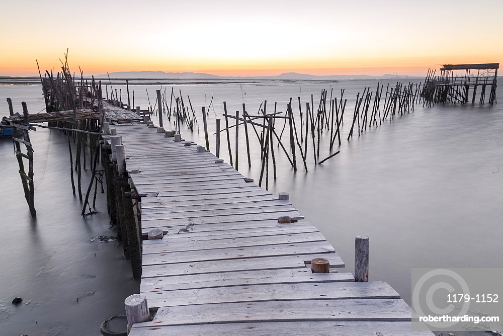 Sunset at Palafito Pier of Carrasqueira, Natural Reserve of Sado River, Alcacer do Sal, Setubal, Portugal, Europe