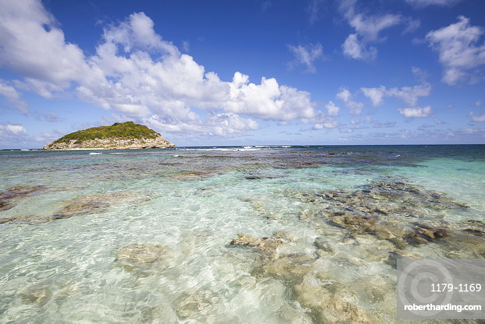 Blue sky and clouds frame the turquoise Caribbean Sea, Half Moon Bay, Antigua and Barbuda, Leeward Islands, West Indies, Caribbean, Central America