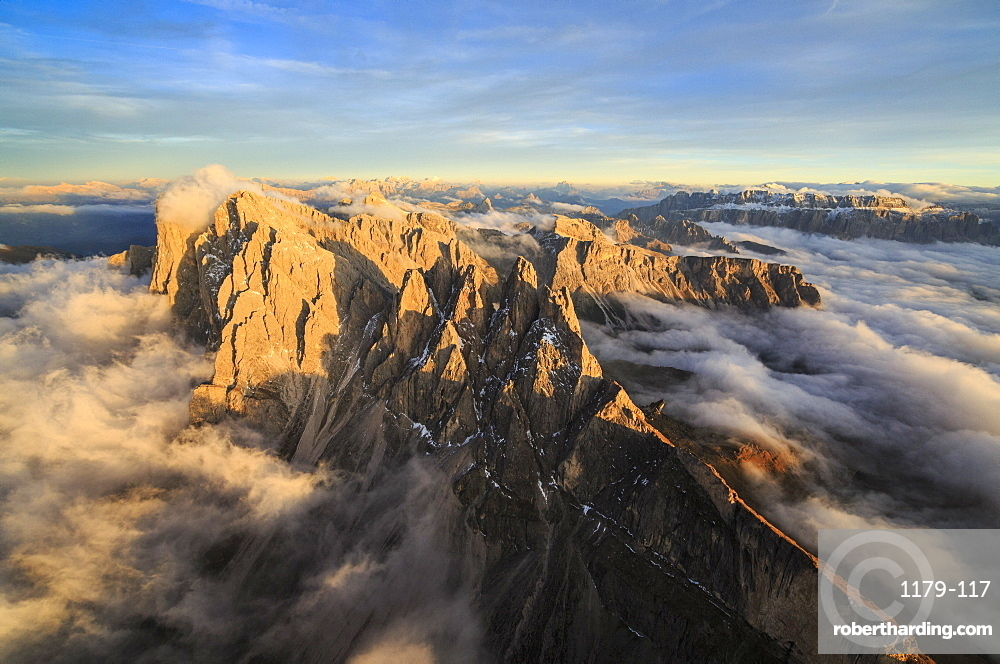 The pinnacles of the Odle Group (Geisler) emerging from the fog, Dolomites, South Tyrol, Italy, Europe