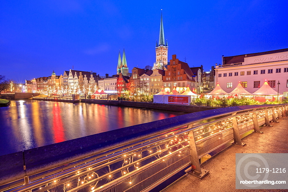 Night view of typical houses and the cathedral reflected in River Trave, Lubeck, Schleswig Holstein, Germany, Europe