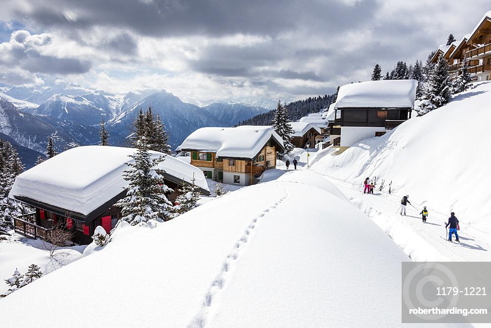 Tourists and skiers enjoying the snowy landscape, Bettmeralp, district of Raron, canton of Valais, Switzerland, Europe