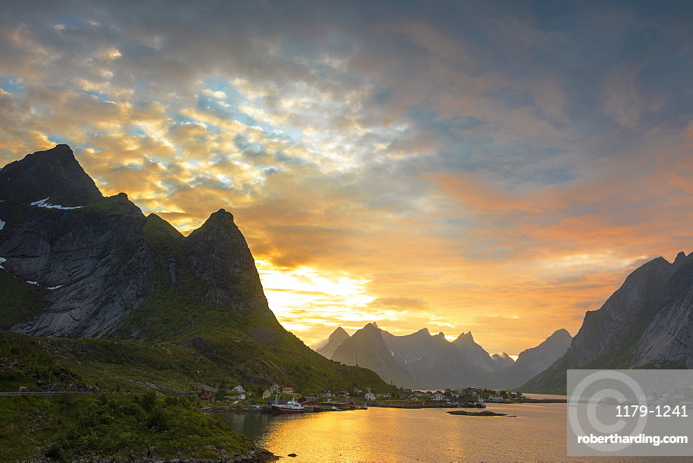 Sunset on the fishing village surrounded by rocky peaks and sea, Reine, Nordland county, Lofoten Islands, Arctic, Northern Norway, Scandinavia, Europe