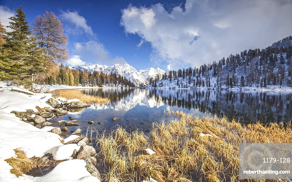 The Brenta Dolomites covered in snow reflecting in the Lake Malghette, Trentino, Italy, Europe