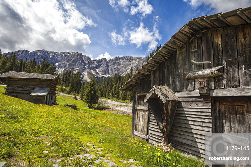 Typical wooden houses in the Funes Valley in the Dolomites by the Passo delle Erbe, South Tyrol, Italy, Europe
