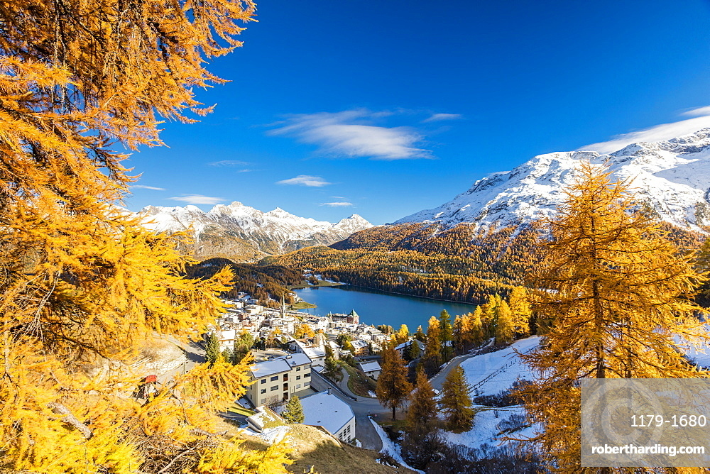 The alpine village of St. Moritz framed by colorful woods and the blue lake, Canton of Graubunden, Engadine, Switzerland, Europe